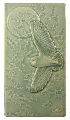 Flying Barn Owl 4 x 8 inches, ceramic art tile.  I desperately wanted to title this tile Flying Barn but getting those looks from my wife made me rethink it. This tile is available in the Celadon green glaze (shown) and the Fog blue glaze. That glaze will be featured in its own listing. This tile can be installed in a fireplace, a back splash, a shower, or simply hung on a wall. As with all my art tiles, the colors are as close to what you see in this image as I can make them, however, due…