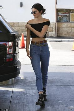 Pumping like a pro: Kendall Jenner showed off her coltish legs in a pair of fitted skinny jeans when she stopped to get petrol in La on Thursday