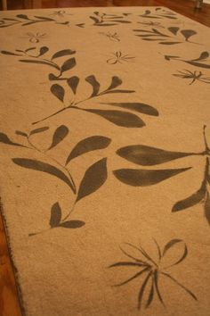 Scattered vines create a #DIY delight. Make your one-of-a-kind rug with Vecco Carpet Colorants and stencils.