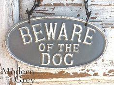 Cast Iron Vintage Inspired Old Fashioned - Beware Of The Dog - Wall Mount Puppy Sign - Distressed Nautical Modern Grey Gray - Concrete. $24.00, via Etsy.