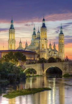 Zaragoza, Spain (Saragossa in English). Is the capital of the Zaragoza Province of Aragon, Spain. It is situated on Ebro River and its tributaries. The building shown in the picture is the Basilica of Our Lady of the Pillars which is a much see! Places Around The World, The Places Youll Go, Places To See, Beautiful Places To Visit, Wonderful Places, Amazing Places, Spain And Portugal, Beautiful Buildings, Travel Photos