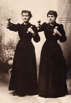 When women first began to work out with weights, it was considered dangerous to have them lift anything heavy and so they were given only two- or four-pound wooden dumbbells. The fact that women lifted much heavier objects in the home seems to have escaped most of the men who designed the exercise. Here two 'cheerful' ladies work out in their street clothes in a photograph c. 1910 by Willis T. White.