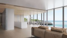 Perched on the edge of a cliff on Ikema Island in southern Japan, this single-family residence seeks to blend modern and contemporary Japanese design aesthetics while offering views toward the East China Sea.