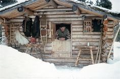 Dick Proenneke in the log cabin that he built by hand..... by himself.