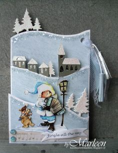 Handmade card by DT member Marleen with decoupage sheet Snoesjes & Music (3DHM073), Collectables Banners & text Christmas (COL1325), Creatables Horizon Pinetrees (LR0283) and Horizon Winter Village (LR0284) from Marianne Design
