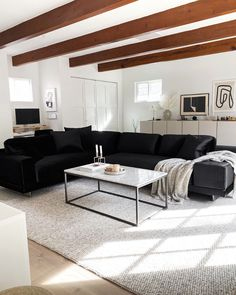 black velvet sectional, wood ceiling beams