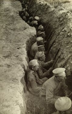Russian WWI soldiers in a trench with bayonets, await a German attack