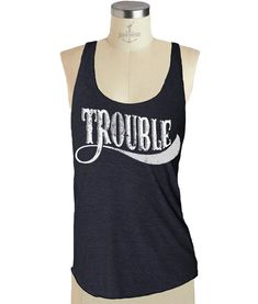 This super comfy TROUBLE tank top is screen printed by us; Skip N Whistle, with eco friendly ink. Super soft racerback os perfect for yoga.  This