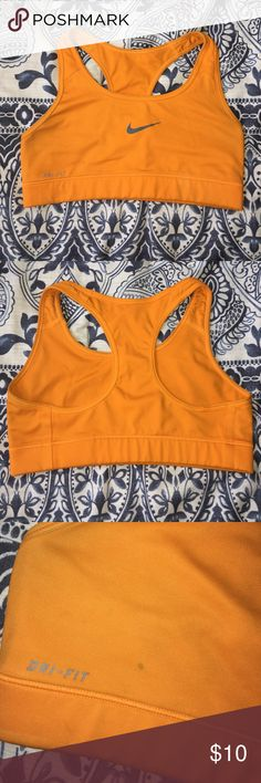Orange Nike Sports Bra The tag is gone but it's a size XS or S. I'm a medium now and it's too tight! It has a small stain (last picture) but not too noticeable. It's a bright orange. Nike Intimates & Sleepwear Bras