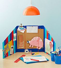 Turn an old cardboard box into the perfect portable study station for your child.