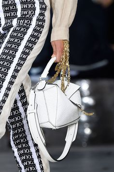 "When it comes to ""It"" handbags Loewe remains to be the one to have and to hold. The brand's ""Puzzle"" piece makes a reappearance in spring 2016 in new colors and shapes, and they have a whole new crop of must-have carryalls.  Shop Loewe at shopBAZAAR.com.    - HarpersBAZAAR.com"