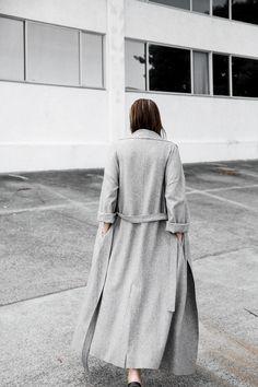 Long, grey, belted coat.