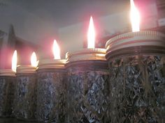 DIY liquid paraffin prepper candles, so easy!!!  Liquid paraffin, small canning jars, 2 lids for each candle, one ring and one lantern wick per lantern.