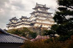 https://flic.kr/p/EF4Ecb | Himeji Castle (姫路城 Himejijo) with Cherry Blossoms in Spring, in Himeji (姫路) Japan | Himeji Castle (姫路城 Himejijo), also named as White Egret Castle (白鷺城), is a beautiful white Japanese castle complex located in Himeji (姫路), Hyogo Prefecture (兵庫県), Japan. It is both a UNESCO world heritage site and a national treasure. The castle is just recently re-opened to public in March 2015 after the 5~6 years extensive renovation work.  Camera Information:  Model: Sony NEX-6…