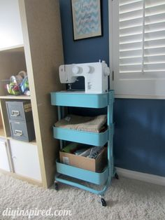 Craft Room Ideas- metal kitchen cart turned craft cart from Ikea!    RÅSKOG  Kitchen cart, turquoise  $49.99	     Article Number:   302.165.36