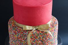 In this video tutorial I demonstrate a super easy way to apply sprinkles / hundreds and thousands onto a buttercream cake and how to assemble a 2 tier cake. ...