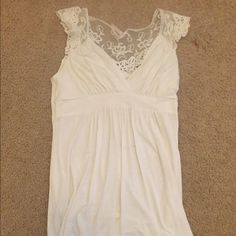 Rue 21 White Sleeveless Top with Lace on Back White Rue 21 top. Has lace and crocheted design on back at the neck area. Used condition but still has a lot of life left. Rue 21 Tops