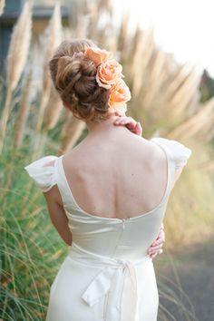 Twisted updo with peach roses | Blue Rose Photography | see more on http://burnettsboards.com/2014/02/spanish-style-bridal-inspiration/