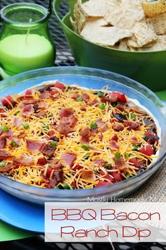 BBQ Bacon Ranch Dip - This addictive dip layers ranch cream cheese, BBQ sauce, bacon, green onion, tomato and cheddar - SO good with tortilla chips!