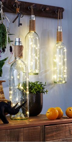 Creative Farmhouse: Wine Bottle DIY Rustic Lanterns for your home or patio decor. Home Decorating Ideas For Cheap ideas creative Home Decorating Ideas For Cheap Creative Farmhouse: Wine Bottle DIY Rustic Lanterns for your home or patio decor. Retro Home Decor, Easy Home Decor, Handmade Home Decor, Diy Decorations For Home, Handmade Decorations, Wedding Decorations, Wedding Centerpieces, Decor Wedding, Light Decorations