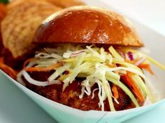 Crab Burgers with Tiger Slaw [with daikon, mango & apple] from Chomp Chomp Nation - seen on Diners, Drive-ins and Dives Slaw Recipes, Burger Recipes, Seafood Recipes, Seafood Dishes, Shellfish Recipes, Yummy Recipes, Recipies, Empanadas, Crab Burger