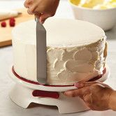 Features:  -Color: Cream.  -Helps decorators spread icing evenly and aids in adding decorative borders to baked goods.  -Stainless steel bearing and has locking switch to keep in one position when nee