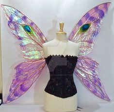 Pair of custom fairy wings, iridescent film hand painted with alcohol inks on an aluminum wire frame. * Please note my wing photos are NOT stock! Do not use without express written permission! * Fo...