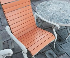 Rather than spend $37+ each, to re-sling my patio chairs, I resurfaced them with wood slats for about $11 each.