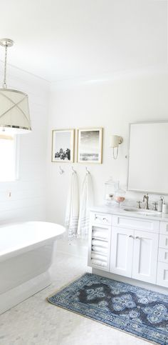 Blogger Monika, of Monika Hibbs, used Polar Bear for her all-white, beachy master bathroom. The color scheme makes this space feel open and airy while pops of color and framed pictures give the room character. Check out her blog post and get inspiration for your own home makeovers.