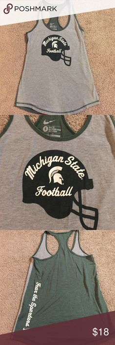 Michigan State NIKE tank Razorback Nike MSU tank. Gray front and Spartan green back. Worn only 2x, excellent condition. No cracking of screen print. Loose fit small. Fits oversized. Perfect with leggings! Smoke free home. Nike Tops Tank Tops
