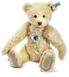 Replica 1934 Teddy Bear by Steiff 402999   Our Steiff Replica 1934 Teddy Bear, item number 402999 is made from the finest blond mohair. fully jointed, features glass eyes and is filled with wood shavings. This superb limited edition piece has the famous Steiff underscored patinated steel Button in the Ear and is a Limited Edition of 1000 pieces Worldwide. Surface washable only, Size 30cm (approx. 12 inches). Comes boxed with certificate of authenticity.
