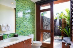Do your deep thinking outside this summer with an outdoor shower — they're easier to set up than you might think.