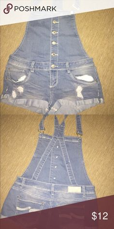 Overall Shorts Denim overall shorts. Open criss cross back. Adjustable straps. Size 9/M Almost Famous Other