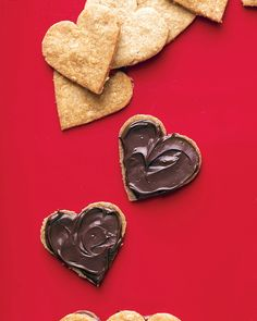 Heart Sandwich Cookies Valentine's Day Cookie Recipes | Martha Stewart Living - These sweet cookies make the best treats for your loved ones.