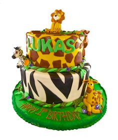 Happy 1st birthday with a 2 tier animal print covered cake complete with edible sculpted animals