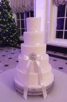 Ivory piped lace embroidery wedding cake