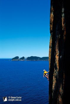 Steve Monks making the first ascent of The Golden Pillar of Fortescue  Fortescue Bay, Tasman Peninsula, Tasmania, Australia.