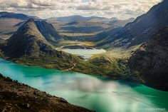 Jotunheimen is a largely undisturbed mountain area in Eastern Norway, covering an area of roughly 3,500 square kilometres. The mountain range is Norway's most popular national park and includes the country's two highest mountains Galdhøpiggen (2,469 metres above sea level) and Glittertind (2,464 metres above sea level), as well as waterfalls, rivers, lakes, glaciers, and valleys.