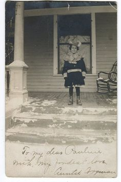 Young Pauline Bryan poses for a photo on her porch in winter in St Paul MN circa 1910