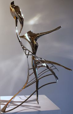"""""""La parisienne"""" By Jean-michel Diki-Paré original stainless steel sculpture available for purchase on www.passionartly.com By buying this artwork you are doing a good deed, we pledge to donate 5% to the association :French Esophageal Atresia Association (AFAO) - French Charity for Children"""