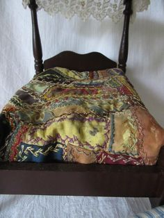 Antique wooden doll bed and quilt