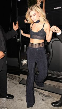 Kendall's pal Hailey Baldwin also flashed some flesh in a black bralet paired with black w...