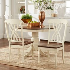 This charming set of chairs would make a lovely addition to the country style furniture in your home. Crafted of solid hardwood with a two-toned buttercream and distressed cherry finish, these curve-backed chairs are as comfortable as they are stylish.