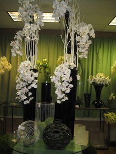 White Orchids in Black Container