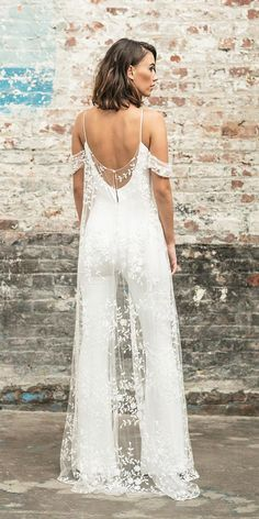 We think a bridal jumpsuit can rival any wedding dress! This dreamy jumpsuit is from the Rime Arodaky Civil collection. The lace cape… Wedding Pantsuit, Rehearsal Dinner Outfits, Wedding Rehearsal Outfit, Rehearsal Dress, Rehearsal Dinners, Wedding Jumpsuit, Homecoming Jumpsuit, Wedding Dress Trends, White Dress For Wedding