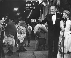 Walt Disney and wife with dwarfs.