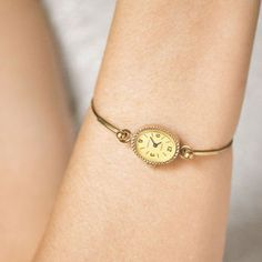 Gold plated watch bracelet Seagull - yellow oval face cocktail watch