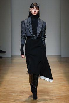 Pinstripe short jacket on asymmetrical long skirt for AquilanoRimondi FW 2017-18 collection.