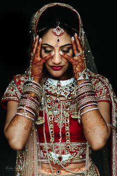An Indian Bride traditional dress, necklace, bracelets and vail, in red and gold colors