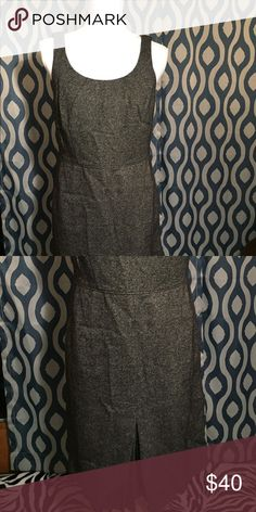 Ann Taylor gray wool dress Never worn. Gray wool sleeveless dress. Pleating detail at bust and bottom of dress. Slight split at bottom of dress to show detail. 54% wool 23% polyester 14% nylon 8% silk 1% elastane (lining 100% acrylic). Dry clean only. Ann Taylor Dresses Midi